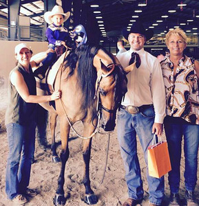 Lizzie Dearing wins it all in her first<br> lead-line class. Another protege<br> of her trainer and coach, Vicki<br> Humphrey, far right.